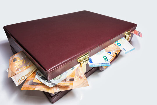 Closed 24 hour briefcase with euro banknotes coming out