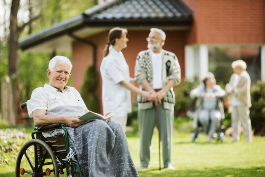 Elderly spending time in the nursing home garden