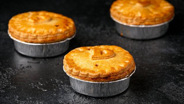 British duck pie on rustic dark background