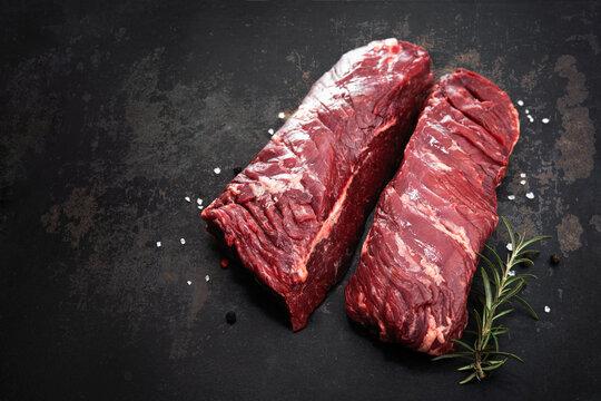 Two raw hanger steaks, also known as butcher's steak or hanging tenderloin