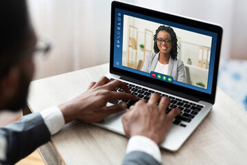 Online Business Meeting. African American Businessman Having Video Conference With Female Partner