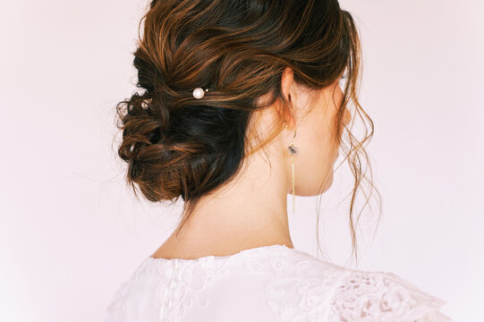 Romantic formal hairstyle on brown hair, back view