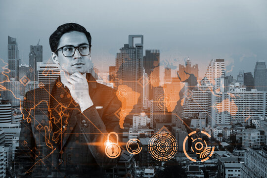 A young handsome eastern cybersecurity developer thinking about new concepts at security compliance division to protect clients confidential information. IT lock icons over Bangkok background.