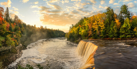 Beautiful sunrise shining on the Upper Tahquamenon Falls in Autumn - Michigan State Park in the Upper Peninsula - waterfall