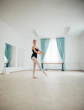 Ballerina dancing in ballet studio