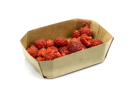 Raspberries in cardboard packaging isolated on white background