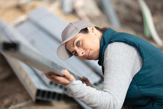 woman worker settling metal material