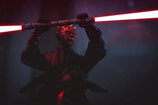 NEW YORK USA - FEB 20 2021: Sith lord Darth Maul  wielding his double blade lightsaber - Hasbro action figure