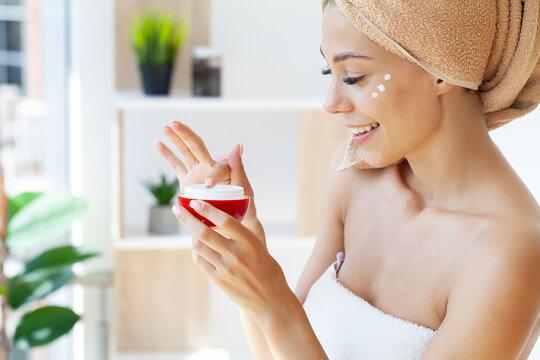 A beautiful woman asia using a skin care product, moisturizer