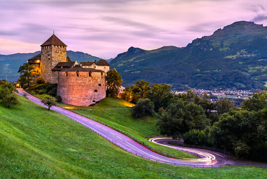 Vaduz Castle with a curvy road in Liechtenstein at sunset