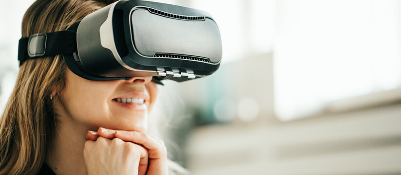 Pretty smiling woman using vr headset. Close-up