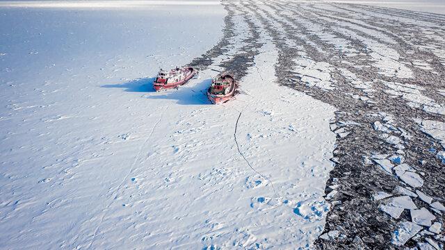 Two icebreakers on Vistula in winter, Poland, Plock