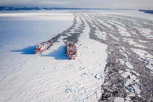Icebreakers on Vistula River breking the ice, Poland