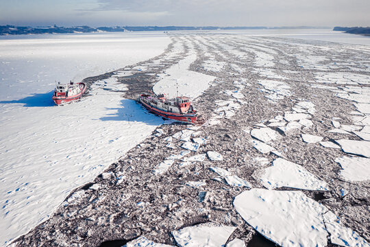 Icebreakers breaking the ice on Vistula River, Poland