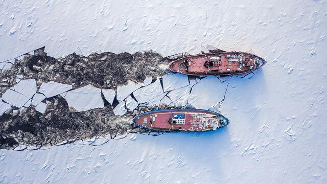 Icebreakers on Vistula river crushes the ice, Poland