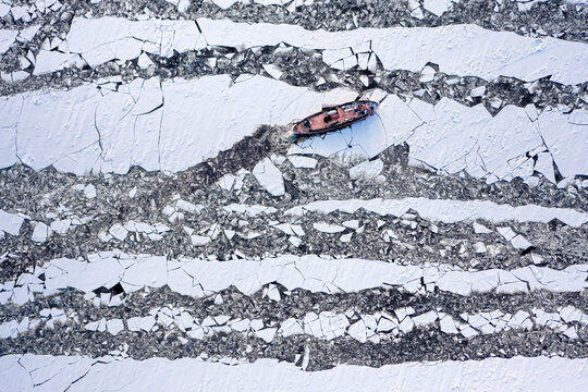 Icebreakers on Vistula river breaking ice, Poland
