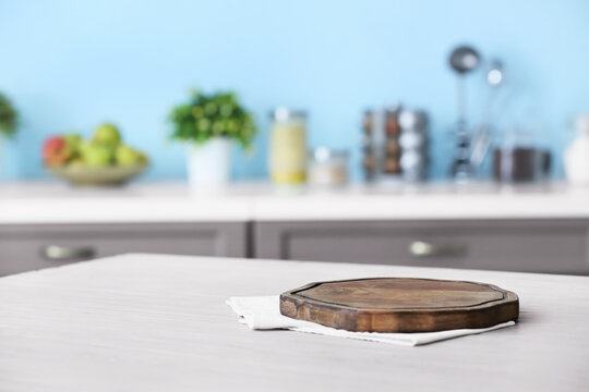 Wooden board on table in modern kitchen