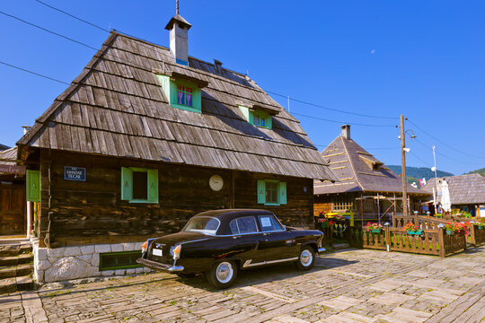 DRVENGRAD, SERBIA - SEPTEMBER 03: Retro cars in traditional village Drvengrad Mecavnik on September 03, 2015 in Drvengrad, Serbia