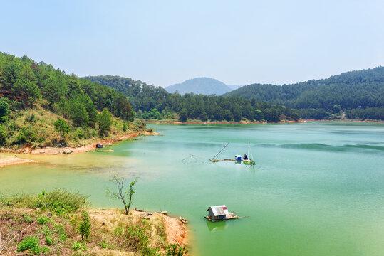 Amazing lake with azure water among green woods