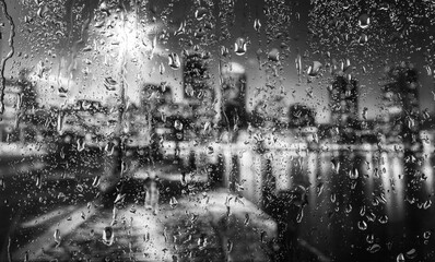 City view through the glass in the rain. Not real city.