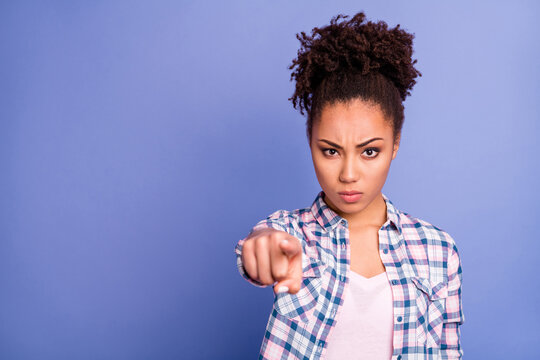 Photo of sad angry young lady dressed checkered shirt pointing you empty space isolated purple color background