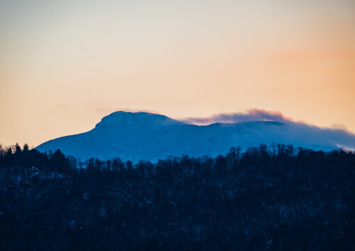Camel's Hump Mountain silhouetted by setting sunlight