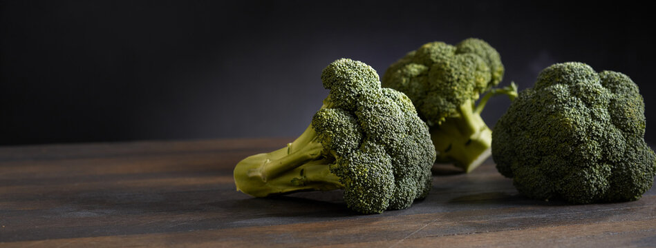 Ripe broccoli on wooden table