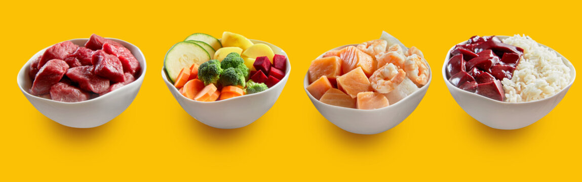 Bowls with yummy fresh dishes on yellow background