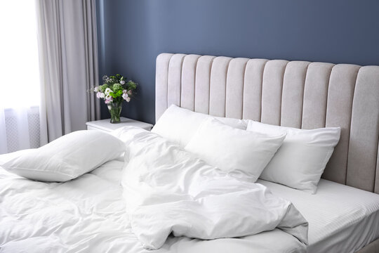 White soft pillows on comfortable bed indoors