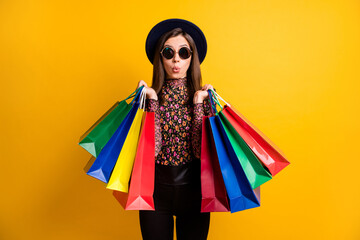Obraz Portraitf of shocked person hold bags lips staring dark headwear retro clothing isolated on yellow color background - fototapety do salonu