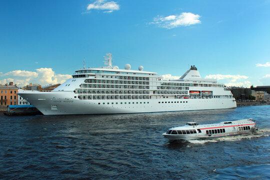 SAINT PETERSBURG, RUSSIA - JULY 4, 2017: Silver Whisper cruise ship at Saint Petersburg's English Embankment pier on Neva river.