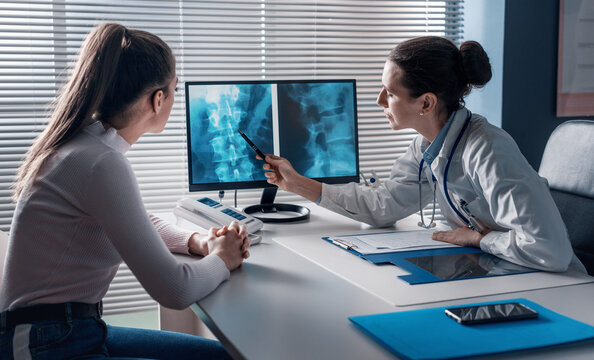Doctor checking a patient's x-ray of spine