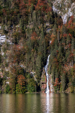 Waterfall at the steep shore of the Koenigssee in Berchtesgadener Land, Bavaria, Germany.