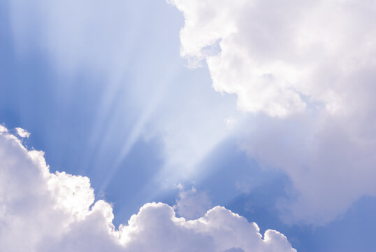 Beautiful blue sky with sunlight coming through clouds