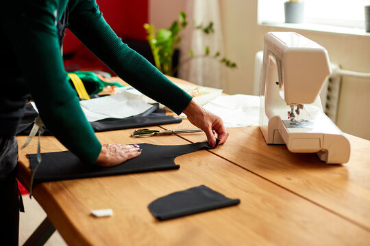 Step by step, woman dressmaker female measuring sewing pattern On Table