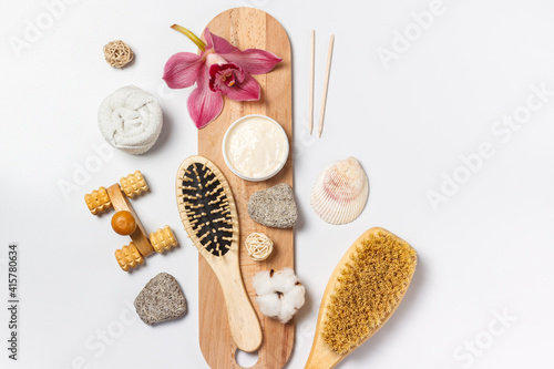 Spa care. Items for spa treatments made of natural materials, scrub, soap with extracts of herbs and flowers. Layout on a white background