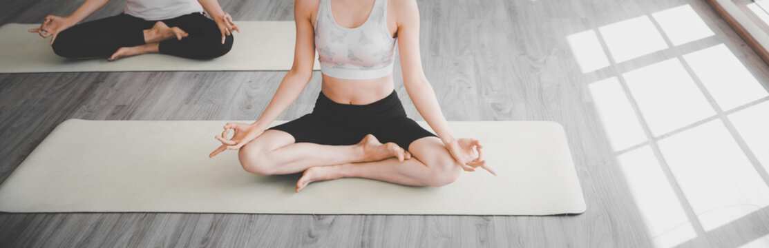 Healthy exercise concept, Women sitting doing yoga at home or studio