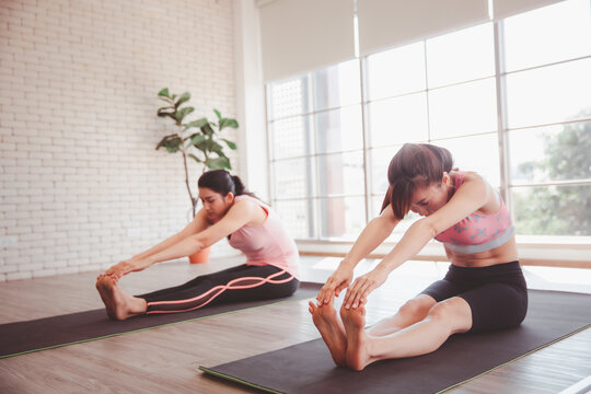 Healthy exercise concept, Women sitting stretching and doing yoga at home or studio