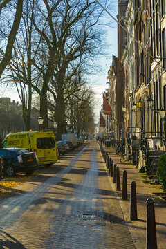 Street view of typical road and house in Amsterdam, Netherlands.