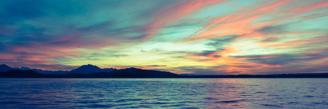 Night sunset panorama. Alps mountains. Lake Zug. Switzerland.
