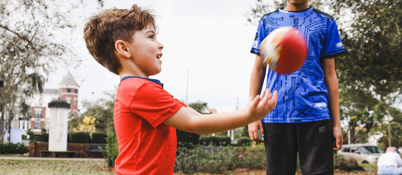 boy playing with a football in winter park florida