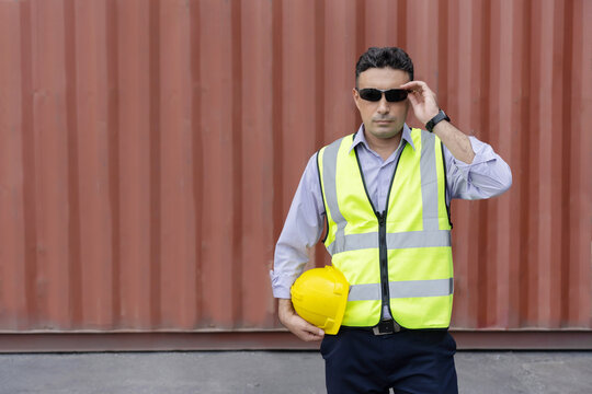 Caucasian Container Worker with Hard Hat Wearing Eyeglasses