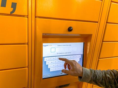 Man using Amazon Locker in shopping mall