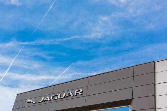 Jaguar brand logo on bright blue sky background