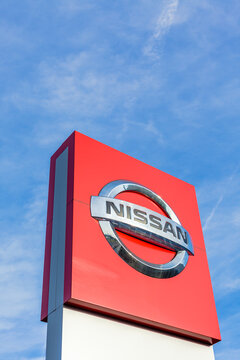 Nissan brand logo on bright blue sky background