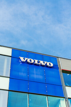 Volvo brand logo on bright blue sky background