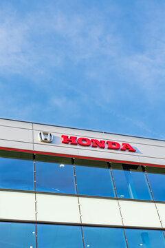 Honda brand logo on bright blue sky background