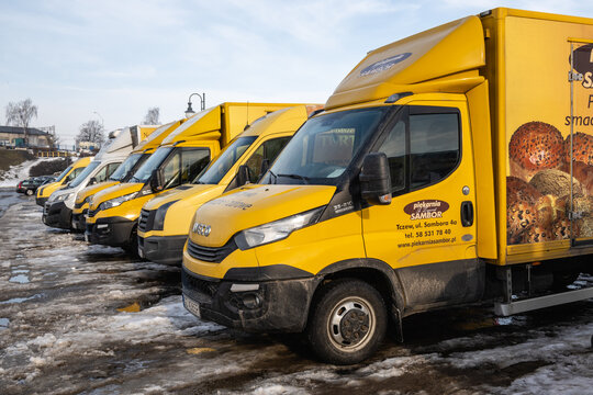 Tczew, Poland - February 21, 2021: A line of yellow trucks at the parking