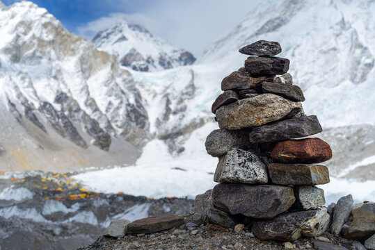 Signpost for hikers on background Everest Base Camp, 5,364 metres (17,598 ft)