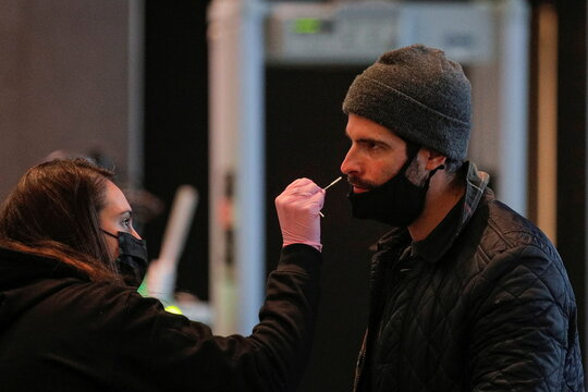 A health care worker swabs a member of the press for a  coronavirus disease (COVID-19) test during check-in for a Brooklyn Nets press event at the Barclays Center in Brooklyn, New York